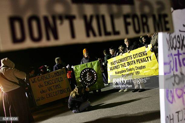 Antideath penalty protesters keep vigil outside of the Osborn Correctional Institution before the execution of convicted murderer Michael Ross May 13...