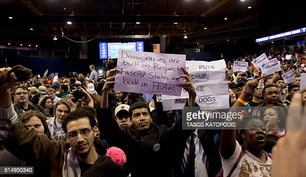 AntiDonald Trump protesters and his supporters confront during a Trump rally at the UIC Pavilion in Chicago on March 11 2016 Republican White House...