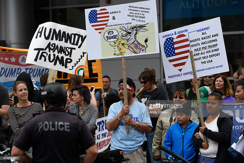 Anti-Donald Trump protesters at the intersection of 14th and California, across the street from the Colorado Convention Center where Mr. Trump was speaking July 01, 2016. The Trump supporter and a protester were detained after the incident.