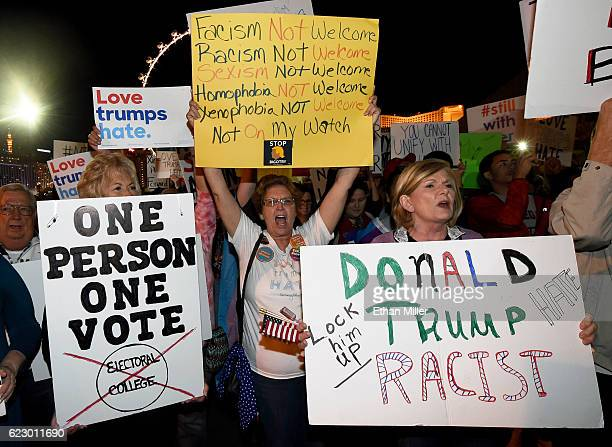 AntiDonald Trump protesters hold signs as they gather at The Linq Promenade before marching on the Las Vegas Strip on November 12 2016 in Las Vegas...