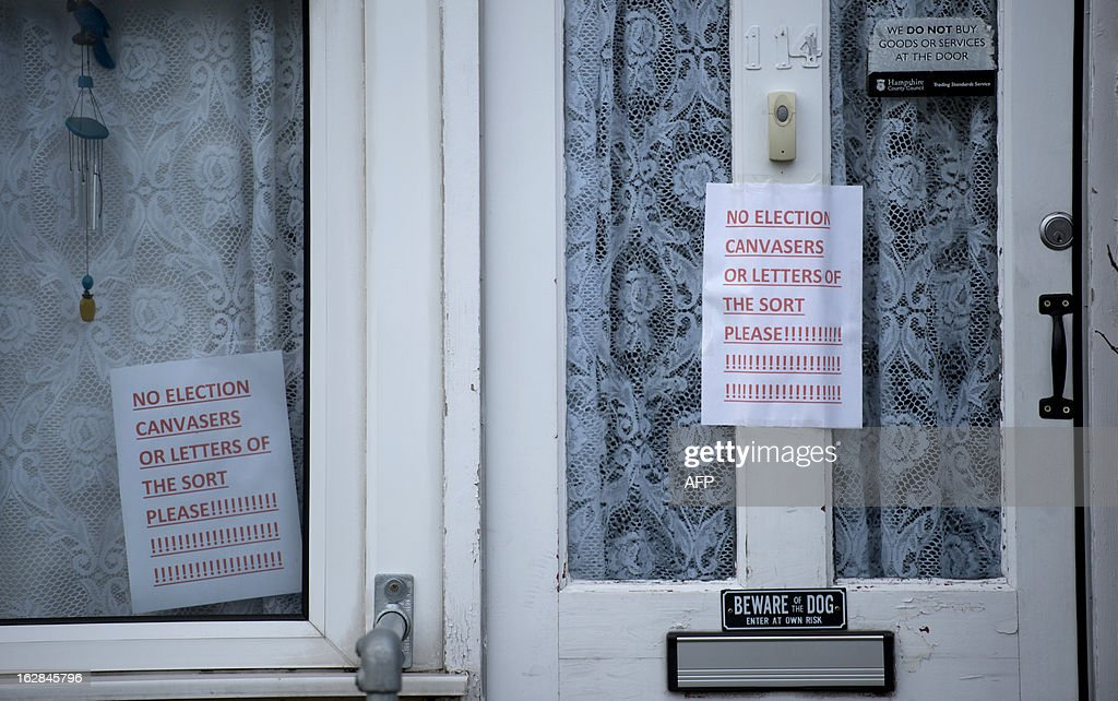 Anti-election canvasing signs are seen pasted to the front door of a house in Eastleigh, Hampshire on February 28, 2013. Voters in the southern English town of Eastleigh went to the polls on February 28 to elect a new member of parliament in a contest that threatens serious repercussions for Britain's main parties.