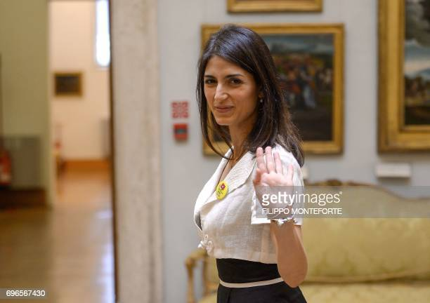 Antiestablishment Five Star Movement Mayor of Rome Virginia Raggi waves as she leaves a press conference at the Musei Capitolini on June 16 2017 Rome...
