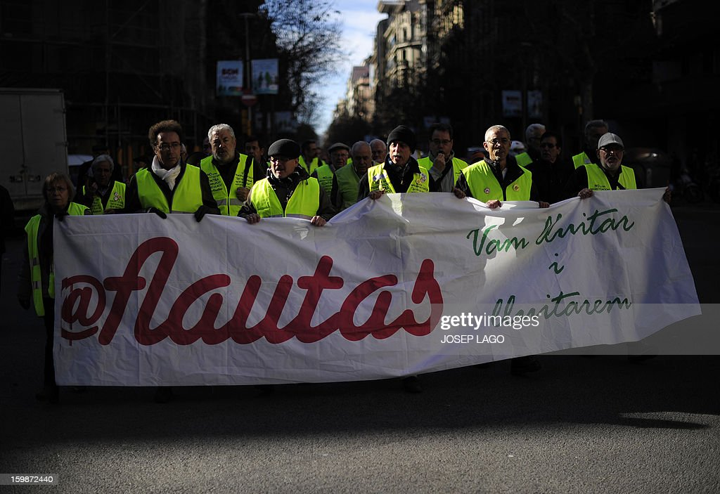 Anti-eviction activists and members of the 'iaioflautas' organization take part in a protest against evictions outside the Spanish Government Delegation headquarters in Barcelona on January 22, 2013.