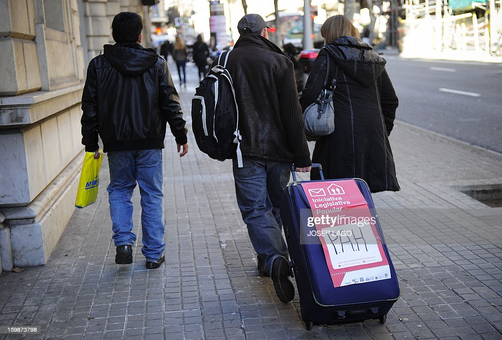 Anti-eviction activists of the PAH (the Platform of People Affected by Mortgage) arrive at the Spanish Government Delegation headquarters in Barcelona to deliver signatures they gathered for a Popular Legislative Initiative (ILP) to stop evictions, regulate dation-in-payment and establish social rents, during a demonstration organized by anti-eviction activists and members of the 'iaioflautas' organization on January 22, 2013.