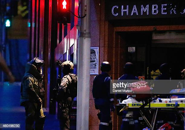 Antiexplosive police officers talk next to the Lindt Cafe Martin Place during a hostage standoff on December 16 2014 in Sydney Australia Police...