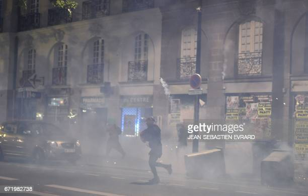 Antifascist demonstrators clash with antiriot police forces as they demonstrate in Nantes western France on April 23 2017 following the announcement...
