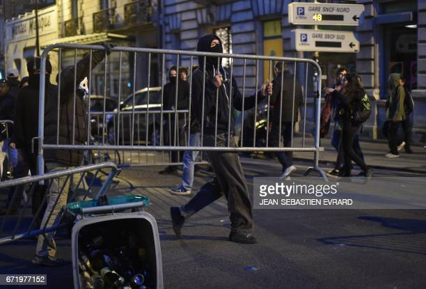 Antifascist demonstrators clash with antiriot police forces in Nantes western France on April 23 2017 following the announcement of the results of...