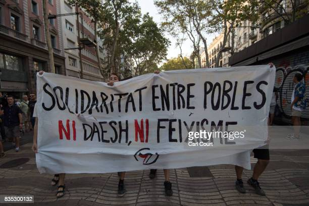 Antifascist protesters carry a banner as they march in protest near the scene of yesterday's terrorist attack on Las Ramblas on August 18 2017 in...