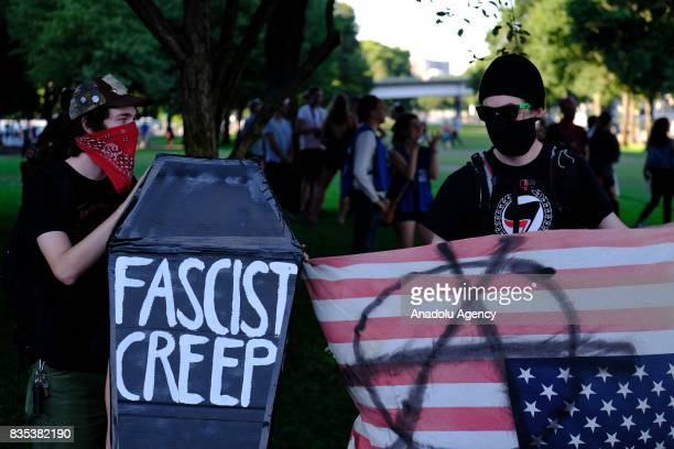 Antifascist protesters hold a coffin at a rally in Portland Ore United States on August 18 to show solidarity against hate with Charlottesville Va...