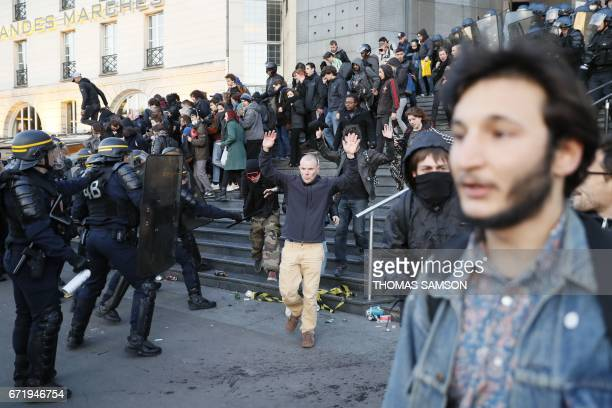 Antifascists clash with antiriot police forces as they demonstrate in Paris on April 23 2017 following the announcement of the results of the first...