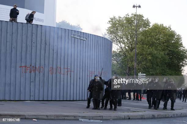Antifascists clash with antiriot police forces during a demonstration in Paris on April 23 2017 following the announcement of the results of the...