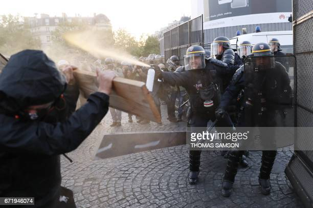 TOPSHOT Antifascists clash with police forces as they demonstrate in Paris on April 23 2017 following the announcement of the results of the first...