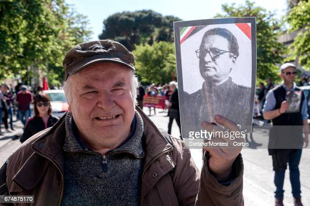Antifascists hold photos as they take part in a parade in remembrance of the struggle for liberation from Nazifascism on April 29 2017 in Rome Italy...