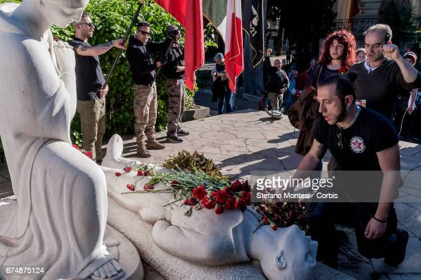 AntiFascists lay a flower on the monument to the partisans in the Verano cemetery during the parade in remembrance of the struggle for liberation...