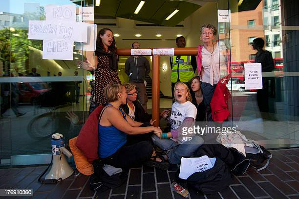 Antifracking and climate protesters block the entrance to the office building housing PR company Bell Pottinger who have worked with British energy...