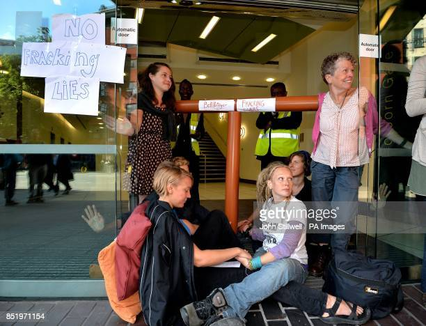 Antifracking demonstrators sit with their hands superglued to each at the offices of Bell Pottinger in High Holborn in central London the PR company...