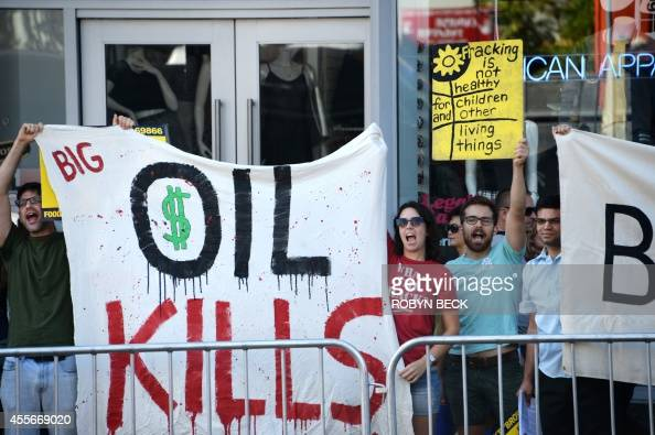 Antifracking protestors yell slogans during a ceremony at which California Governor Jerry Brown signed into law AB1839 the California Film and...
