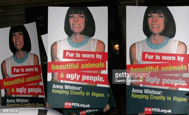 AntiFur protesters with signs are seen outside the American British Vogue London Fashion Week cocktail party at Luciano on February 17 2006 in London...