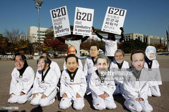 AntiG20 activists from Oxfam wear masks depicting the G20 leaders during a rally on November 10 2010 in Seoul South Korea World leaders will converge...