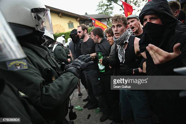 AntiG7 protesters confront riot police during scuffles that involved tear gas and pepper spray during a march through the city center the day before...