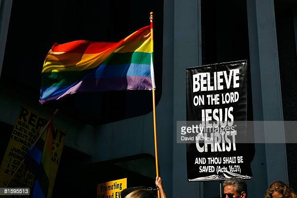 Antigay religious protesters picket near a gay pride flag at the ceremony of lesbian couple Robin Tyler and Diane Olson after they were married in...