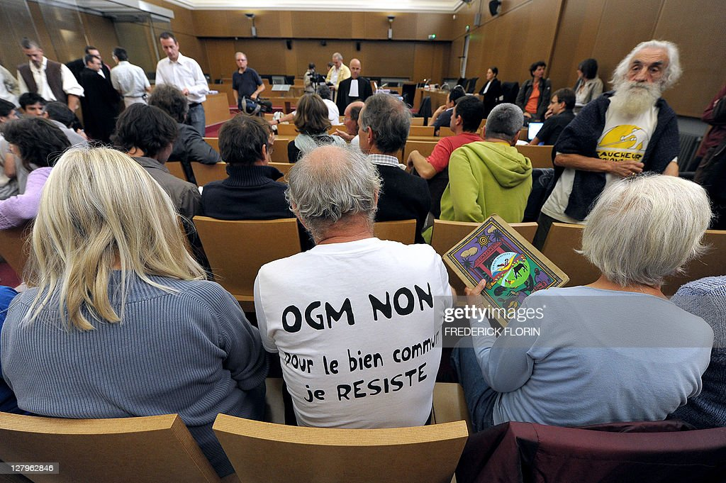 Anti-Genetically Modified Organisms (GMO) militants wait for the start of their trial at Colmar courthouse on September 28, 2011, eastern France, accused of destroying MGO plants.