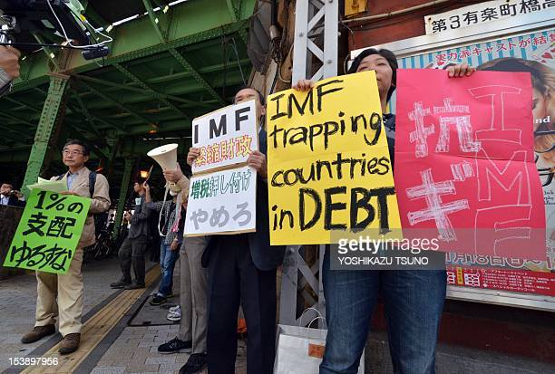 Antiglobalism activists stage a protest outside of the annual meetings of the World Bank and International Monetary Fund in Tokyo on October 11 2012...