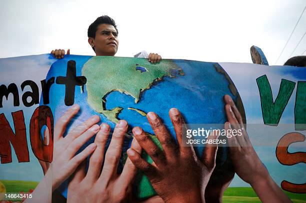 Antiglobalization activists protest against the construction of a Walmart megastore in a forest of the suburbian town of Mejicanos El Salvador on...