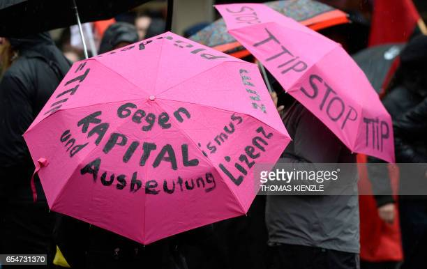Antiglobalization demonstrators protest with umbrella reading 'Against Capitalism and exploitation' on the sidelines of the G20 Finance Ministers and...
