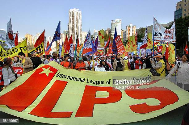 Antiglobalization protesters garry a huge banner during a demonstration against the sixth World Trade Organisation ministerial conference in Hong...
