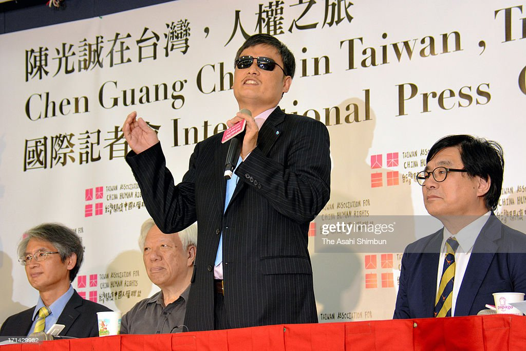 Anti-government activist <a gi-track='captionPersonalityLinkClicked' href=/galleries/search?phrase=Chen+Guangcheng&family=editorial&specificpeople=4103134 ng-click='$event.stopPropagation()'>Chen Guangcheng</a> speaks during a press conference in Taipei, Taiwan. Dissident Chen, who now live in the United States, will be staying in Taiwan until July 11.