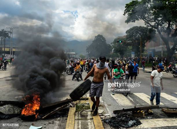Antigovernment activists build a barricade in Venezuela's third city Valencia on August 6 a day after a new assembly with supreme powers and loyal to...