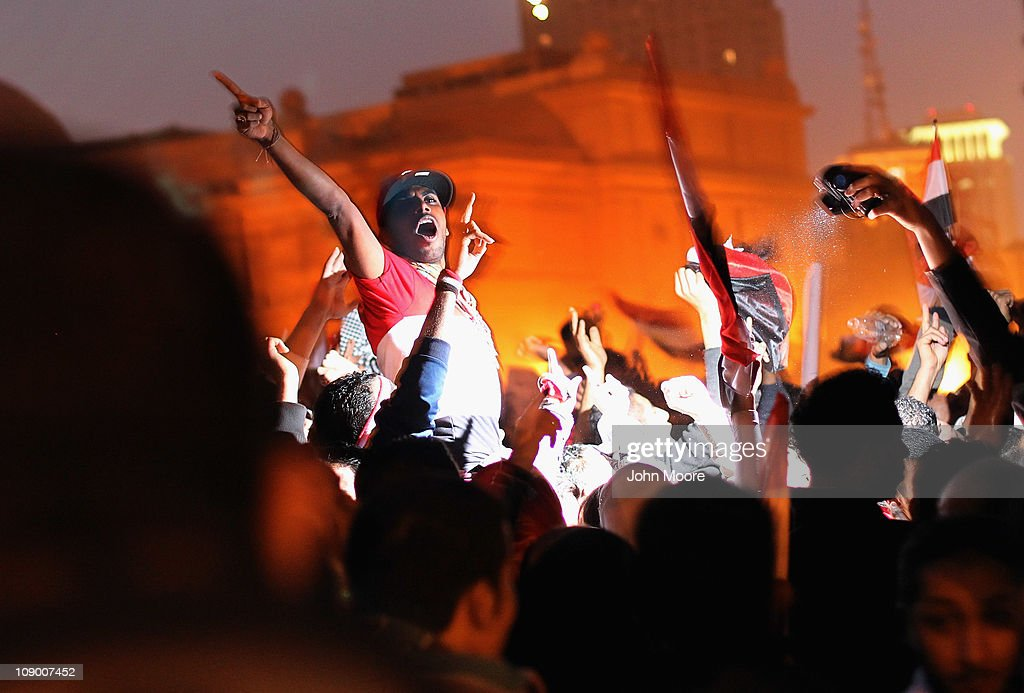 Anti-government demonstrators celebrate in Tahrir Square upon hearing the news of the resignation of Egyptian President Hosni Mubarak on February 11, 2011 in Cairo, Egypt. After 18 days of widespread protests, Egyptian President Hosni Mubarak, who has now left Cairo for his home in the Egyptian resort town of Sharm el-Sheik, announced that he would step down.
