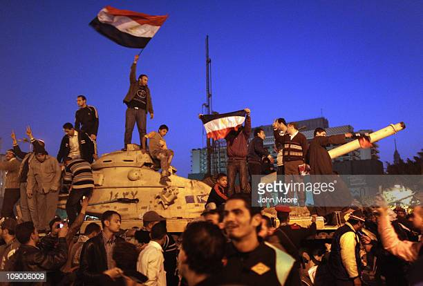 Antigovernment demonstrators celebrate upon hearing the news of the resignation of Egyptian President Hosni Mubarak on February 11 2011 in Cairo...