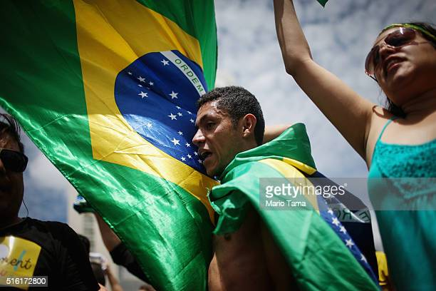 Antigovernment demonstrators chant with Brazilian flags outside the National Congress building during demonstrations on March 17 2016 in Brasilia...