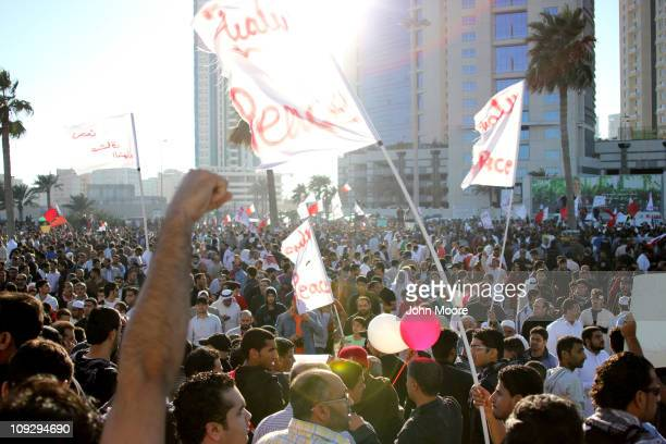 Antigovernment demonstrators rally as they reoccupy Pearl roundabout on February 19 2011 in Manama Bahrain Antigovernment protesters were fired at...