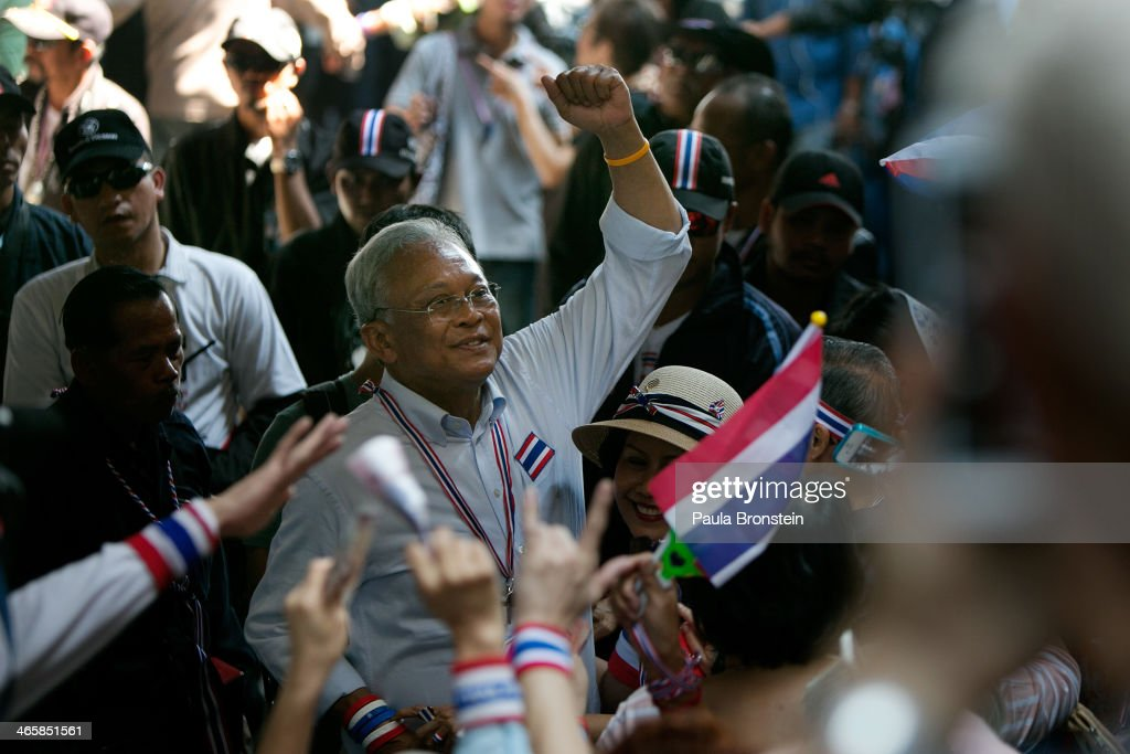 Anti-government leader <a gi-track='captionPersonalityLinkClicked' href=/galleries/search?phrase=Suthep+Thaugsuban&family=editorial&specificpeople=5734971 ng-click='$event.stopPropagation()'>Suthep Thaugsuban</a> marches with protesters down a major street on January 30, 2014 in Bangkok, Thailand. The general elections will take place on February 2 as the anti-government protesters vow to cause chaos by blocking polling stations. Bangkok Shutdown has been in effect for over two weeks as the anti-government protesters continue to block major intersections. The Thai government imposed a 60-day state of emergency in Bangkok and the surrounding provinces in an attempt to cope with the on-going political turmoil however this decree has had no effect on the mass protests.