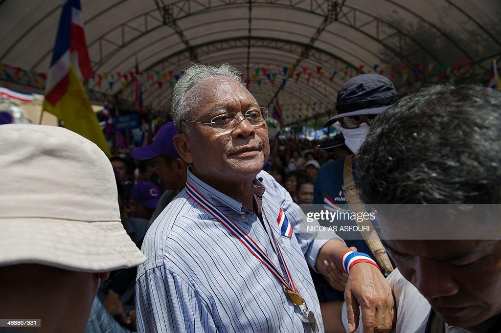 Anti-government protest leader <a gi-track='captionPersonalityLinkClicked' href=/galleries/search?phrase=Suthep+Thaugsuban&family=editorial&specificpeople=5734971 ng-click='$event.stopPropagation()'>Suthep Thaugsuban</a> (C) arrives through the crowd at Government House in Bangkok on May 9, 2014. Thai protesters vowed to besiege television stations and police positions as they launched a 'final fight' to topple a government that is on the ropes after its leader was dismissed. AFP PHOTO/ Nicolas ASFOURI