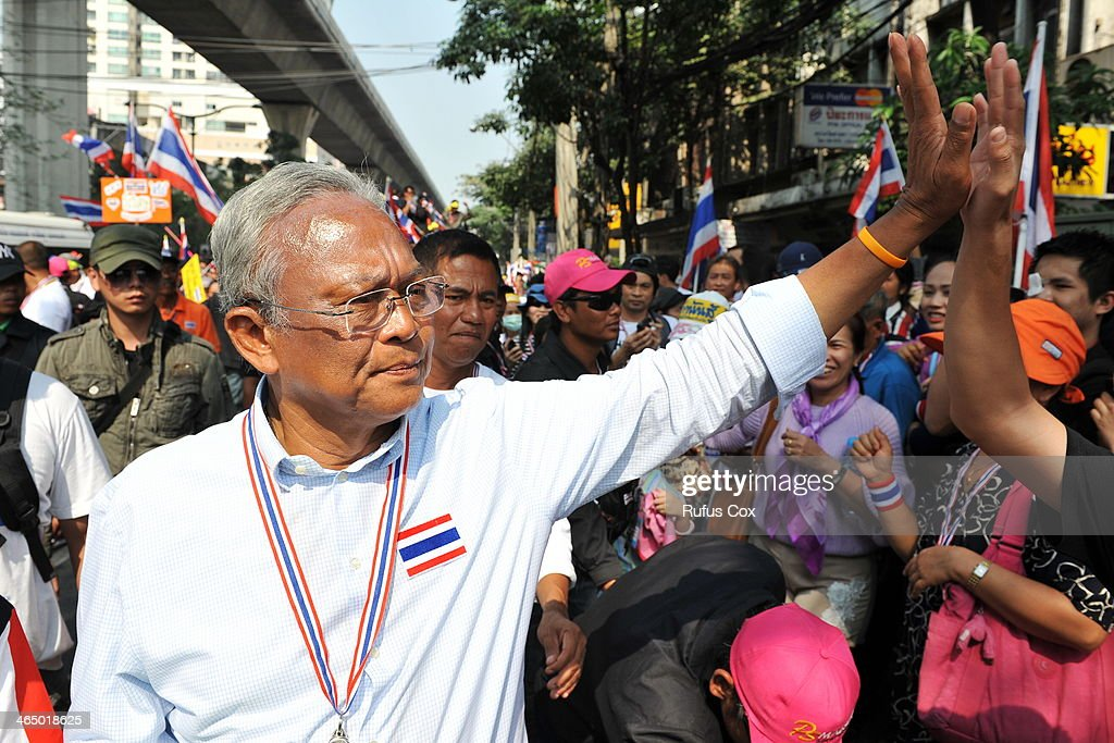 Anti-government protest leader <a gi-track='captionPersonalityLinkClicked' href=/galleries/search?phrase=Suthep+Thaugsuban&family=editorial&specificpeople=5734971 ng-click='$event.stopPropagation()'>Suthep Thaugsuban</a> greets supporters during a city centre march on January 25, 2013 in Bangkok, Thailand. Protesters have defied a government declared state of emergency by holding rallies throughout the capital. The emergency law was announced amid ongoing political rallies aimed at toppling the government and derailing a snap-poll scheduled for early February. Thai protest leader <a gi-track='captionPersonalityLinkClicked' href=/galleries/search?phrase=Suthep+Thaugsuban&family=editorial&specificpeople=5734971 ng-click='$event.stopPropagation()'>Suthep Thaugsuban</a> has reportedly promised that his supporters will not obstruct the advanced voting for next week's general election, but will still demonstrate outside polling stations.