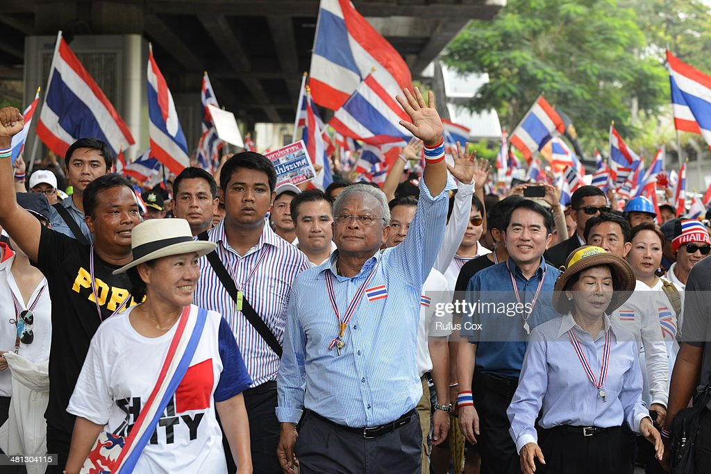 Anti-government protest leader <a gi-track='captionPersonalityLinkClicked' href=/galleries/search?phrase=Suthep+Thaugsuban&family=editorial&specificpeople=5734971 ng-click='$event.stopPropagation()'>Suthep Thaugsuban</a> (C) leads a large rally through the city centre on March 29, 2014 in Bangkok, Thailand. Tens of thousands of anti-government protesters marched through the Thai capital in calling for political reform to take place before elections and the ouster of caretaker Prime Minister Yingluck Shinawatra, who is facing mounting pressure over resumed street protests and a corruption case being heard in the Thai courts. Thailand's current turmoil has lasted for several months with no sign of a breakthrough in the political deadlock.