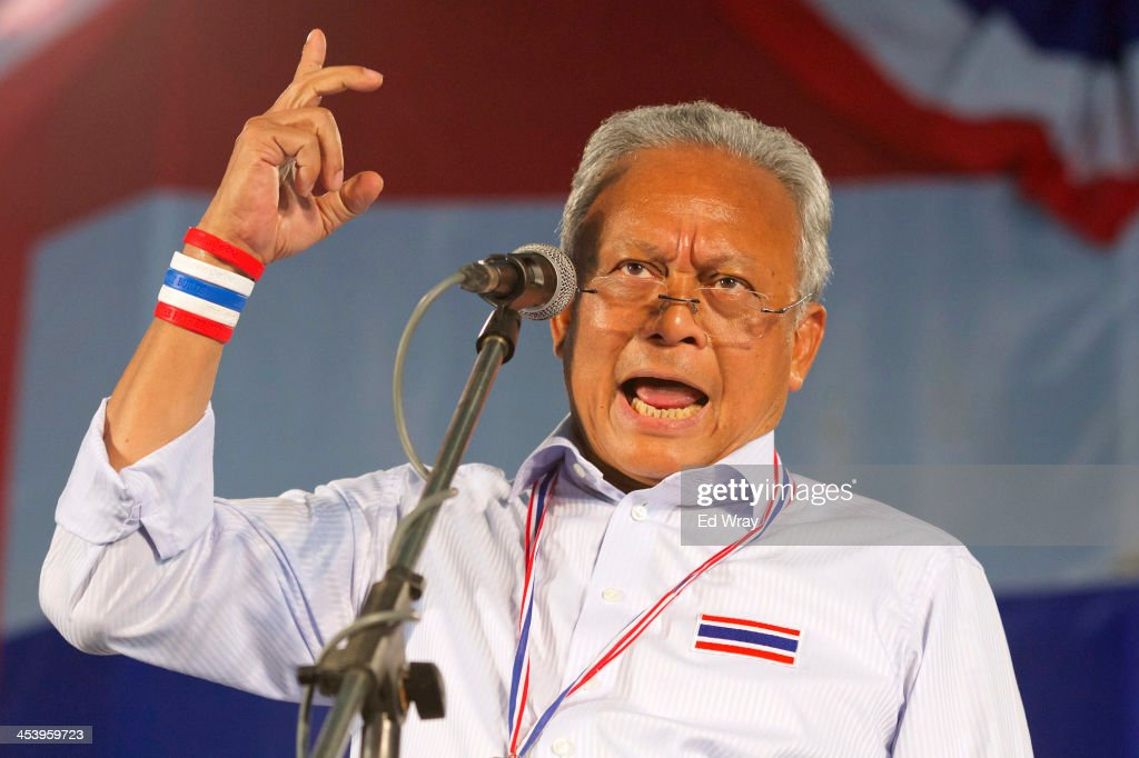 Anti-government protest leader <a gi-track='captionPersonalityLinkClicked' href=/galleries/search?phrase=Suthep+Thaugsuban&family=editorial&specificpeople=5734971 ng-click='$event.stopPropagation()'>Suthep Thaugsuban</a> speaks during an address to thousands of his followers December 6, 2013 in Bangkok, Thailand. The relative calm after recent violent clashes paused for the Thai King's birthday continued, despite overnight reports that several people were injured in an attack on anti-government protesters occupying the Thai Ministry of Finance.