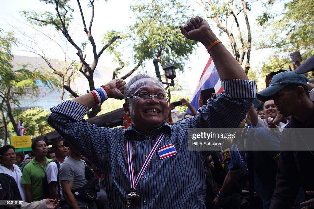 Anti-government protest leader Suthep Thaugsuban waves to his supporters during a rally in Bangkok. Major intersections were blocked in Thailand's capital as protesters began a 'Bangkok shutdown' campaign to force out the government of caretaker Prime Minister Yingluck Shinawatra. Thai anti-government protesters said they would set up protest camps at seven main intersections in Bangkok in their bid to paralyse the capital. Protest leader Suthep Thaugsuban said 'We will do it all days and we will do it everyday until we win''.