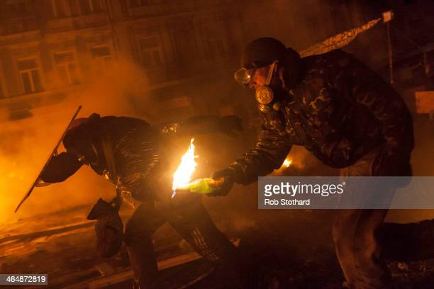 Antigovernment protesters attack police near Dynamo Stadium on January 24 2014 in Kiev Ukraine Talks to resolve the political stalemate in the...