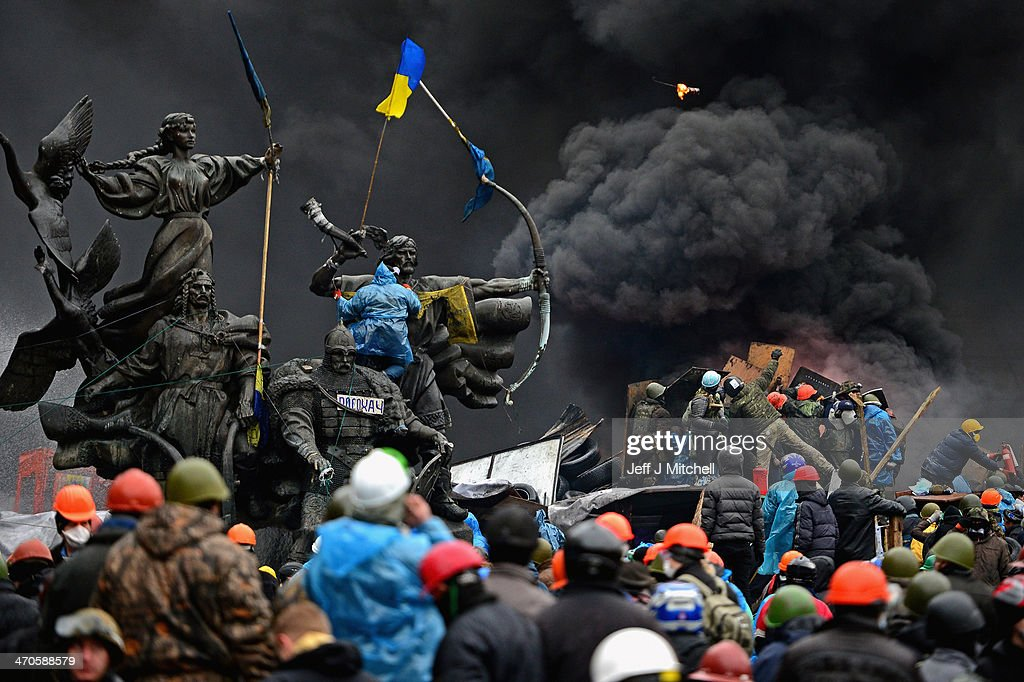 Anti-government protesters continue to clash with police in Independence square, despite a truce agreed between the Ukrainian president and opposition leaders on February 20, 2014 in Kiev, Ukraine. After several weeks of calm, violence has again flared between police and anti-government protesters, who are calling for the ouster of President Viktor Yanukovych over corruption and an abandoned trade agreement with the European Union.