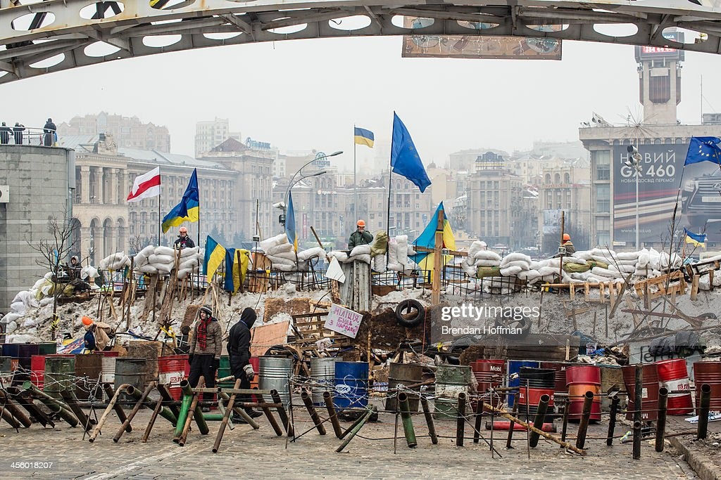 Anti-government protesters continue to fortify their barricades intended to block the police from forcing them out of Independence Square on December 13, 2013 in Kiev, Ukraine. Thousands of people have been protesting against the government since a decision by Ukrainian president Viktor Yanukovych to suspend a trade and partnership agreement with the European Union in favor of incentives from Russia.