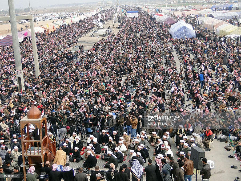 Anti-government protesters demonstrate after the weekly Friday prayer in the western Iraqi city of Ramadi on January 18, 2013. Thousands of Sunni Muslims took to the streets of the capital Baghdad and other parts of Iraq on to decry the alleged targeting of their minority, in rallies hardening opposition to the country's Shiite leader.