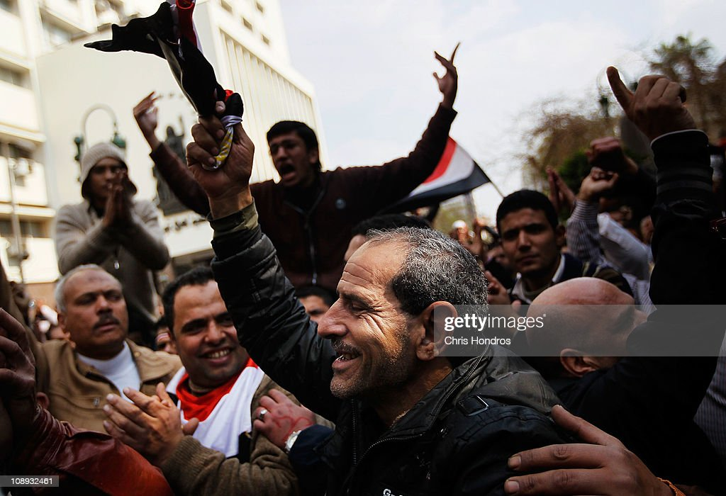 Anti-government protesters demonstrate near the Egyptian Parliament building on February 9, 2011 in Cairo, Egypt. Thousands of Egyptians protested outside of the parliament building in downtown Cairo to demand the assembly's immediate dissolution following waves of anti-government protests in the nearby Tahrir Square.