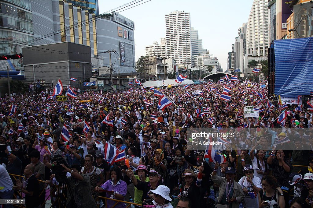 Anti-government protesters during a rally at Asoke intersection in Bangkok. Major intersections were blocked in Thailand's capital as protesters began a 'Bangkok shutdown' campaign to force out the government of caretaker Prime Minister Yingluck Shinawatra. Thai anti-government protesters said they would set up protest camps at seven main intersections in Bangkok in their bid to paralyse the capital. Protest leader Suthep Thaugsuban said 'We will do it all days and we will do it everyday until we win''.