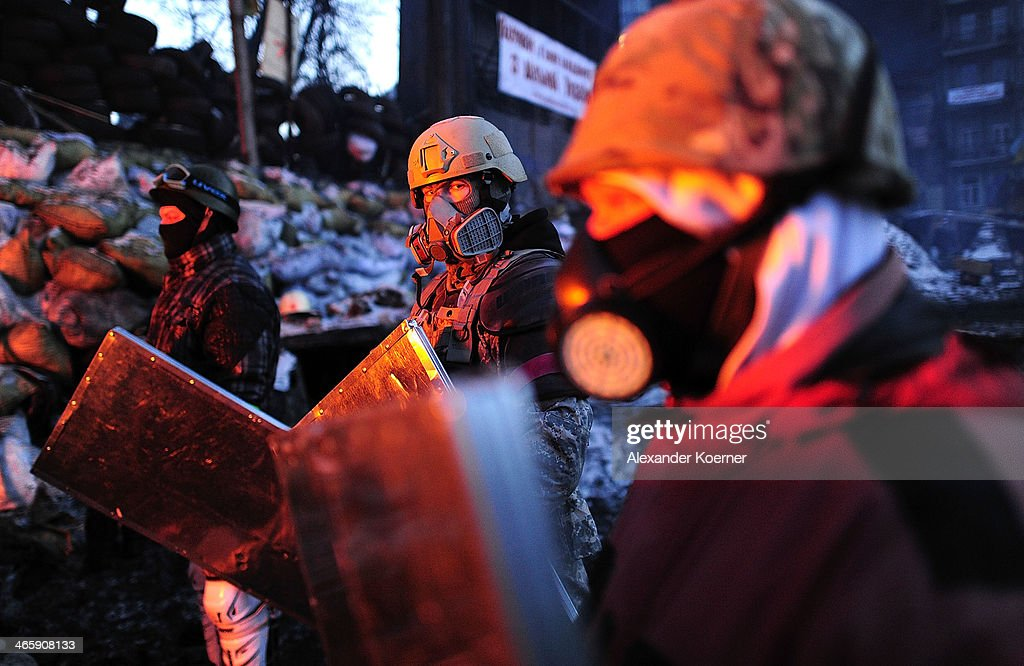 Anti-government Protesters gather around a fire at a barricade on Grushevskoho Street on January 30, 2014 in Kiev, Ukraine. Ukraine's Prime Minister Mykola Azarov and his cabinet resigned two-days ago following months of protests, while parliament is also scrapping a number of controversial anti-protest laws. Radical anti-government protesters have started to build new walls inside the existing barricades in defiance of the Government's proposed Amnesty.