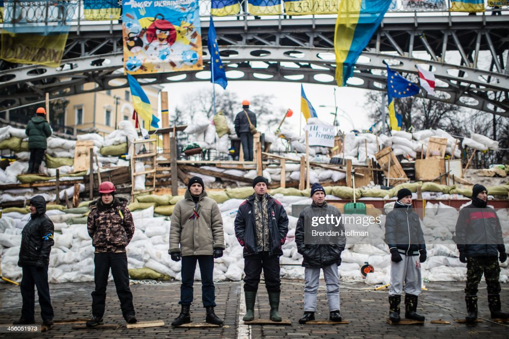 Anti-government protesters guard a barricade designed to keep police from evicting them from Independence Square on December 13, 2013 in Kiev, Ukraine. Thousands of people have been protesting against the government since a decision by Ukrainian president Viktor Yanukovych to suspend a trade and partnership agreement with the European Union in favor of incentives from Russia.